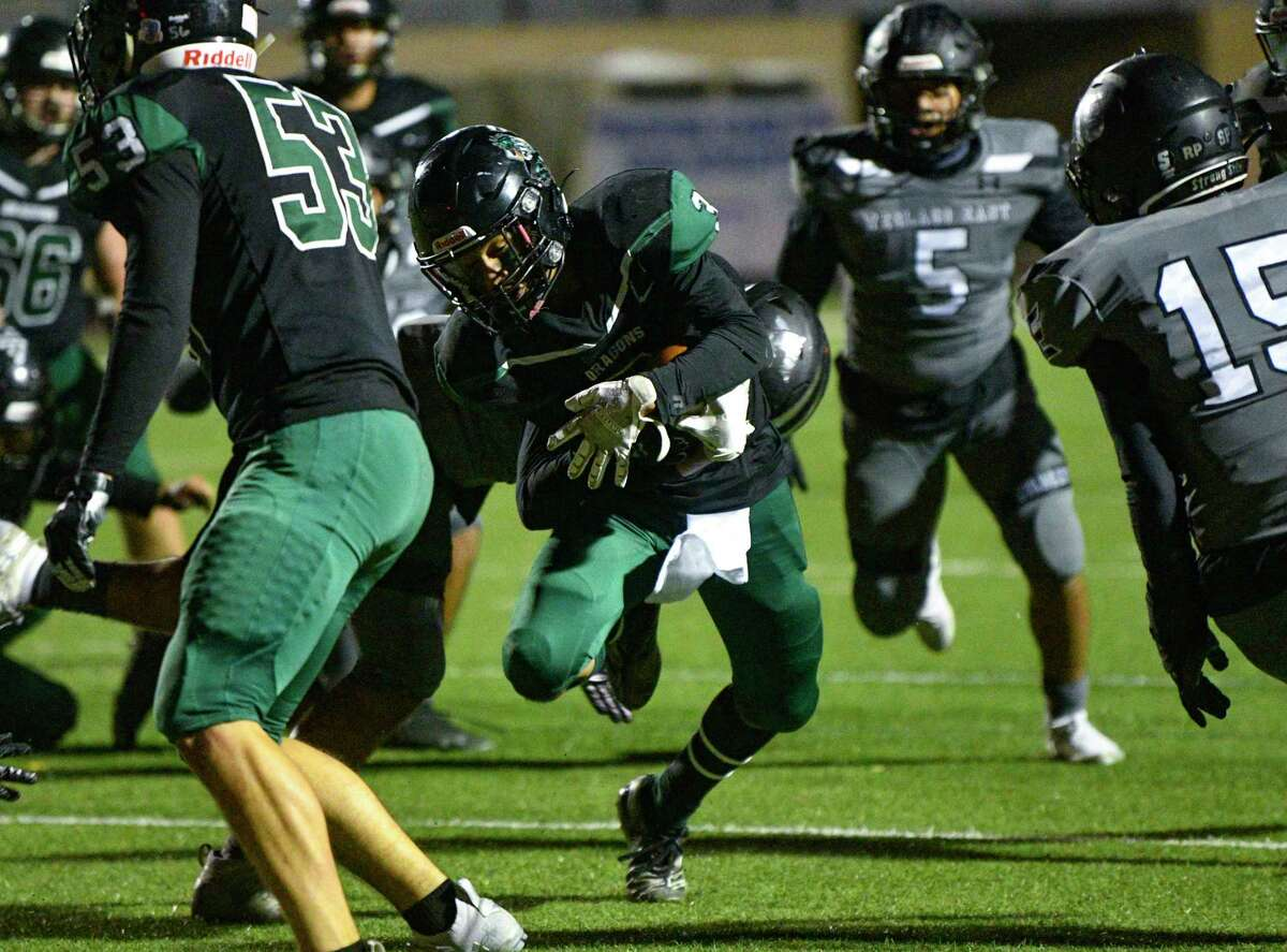 Trey Cano of Southwest runs for yardage against Weslaco East during high school football playoffs action at Dub Farris Stadium on Friday, Dec. 18, 2020.