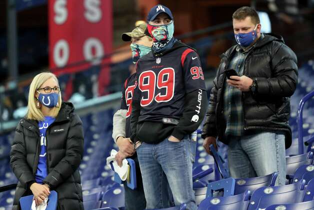 Houston Texans and Indianapolis Colts fans make their way into the stadium before an NFL football game at Lucas  Field Sunday, Dec. 20, 2020, in Indianapolis. Photo: Brett Coomer, Staff Photographer / © 2020 Houston Chronicle