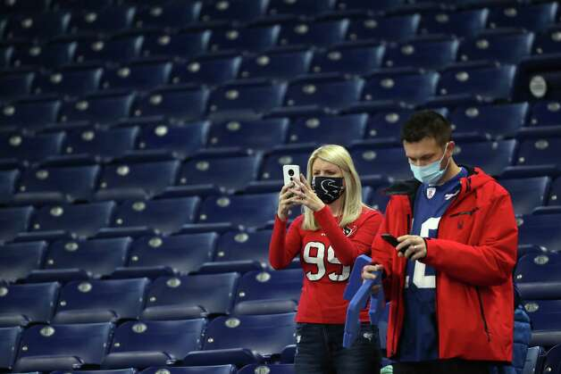 Houston Texans and Indianapolis Colts fans take pictures with their phones as they watch the teams warm up before an NFL football game at Lucas  Field Sunday, Dec. 20, 2020, in Indianapolis. Photo: Brett Coomer, Staff Photographer / © 2020 Houston Chronicle