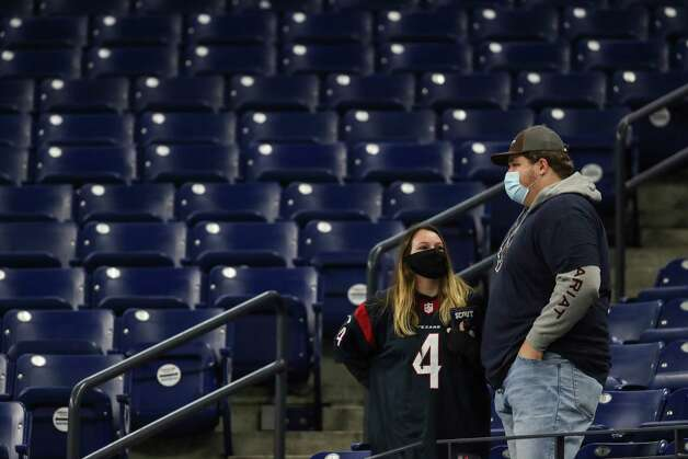 Houston Texans fans make their way into the stadium before an NFL football game against the Indianapolis Colts at Lucas  Field Sunday, Dec. 20, 2020, in Indianapolis. Photo: Brett Coomer, Staff Photographer / © 2020 Houston Chronicle