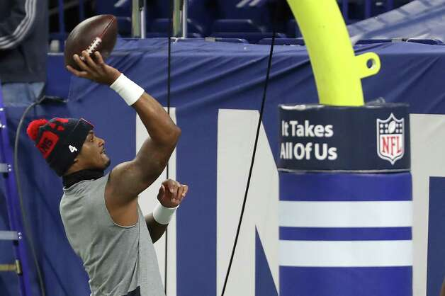 Houston Texans quarterback Deshaun Watson throws a football to a fan before an NFL football game against the Indianapolis Colts at Lucas  Field Sunday, Dec. 20, 2020, in Indianapolis. Photo: Brett Coomer, Staff Photographer / © 2020 Houston Chronicle