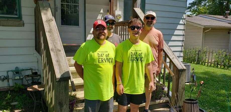 Faith Coalition volunteers repaired deteriorating back stairs and handrails for an elderly resident. Photo: For The Intelligencer