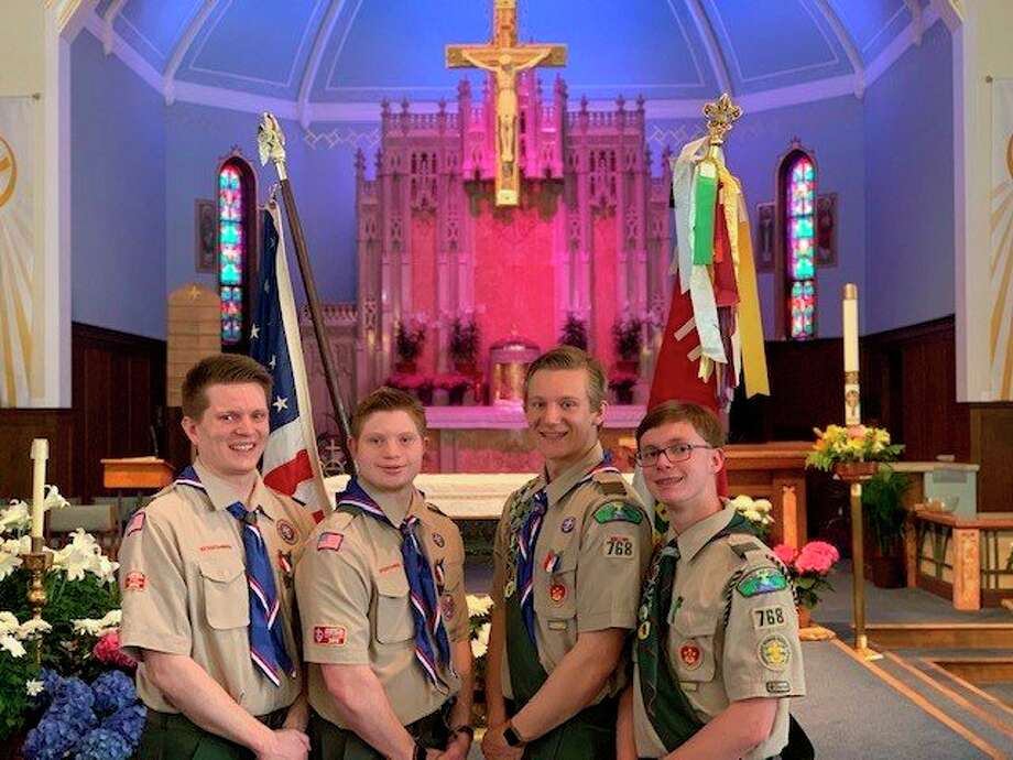 From left, Luke, Adam, John and Eric White pose in their Boy Scout uniforms. (Photo provided/Kim White)