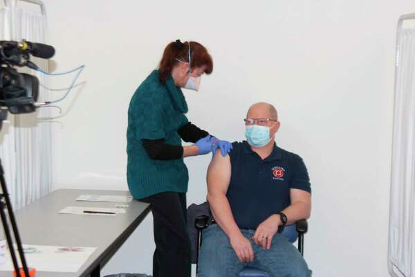 A member of Benzie County's first responder community gets vaccinated against COVID-19 on Sunday. (Colin Merry/Record Patriot)