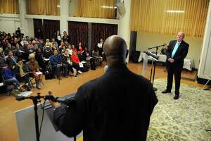 Bridgeport Police Chief AJ Perez listens to Rev. Anthony Bennett of Mt. Aery Baptist Church, during the 6th Annual Delegate Assembly of CONECT (Congregations Organized for a New Connecticut) at the Bridgeport Islamic Community Center in Bridgeport, Conn., Nov. 30, 2017. CONECT leaders pressed Chief Perez, who no longer holds the office, for action on body cameras for police officers, public scrutiny of police training on racial/cultural sensitivity and de-escalation and transparency during investigations into police use of force/police misconduct.