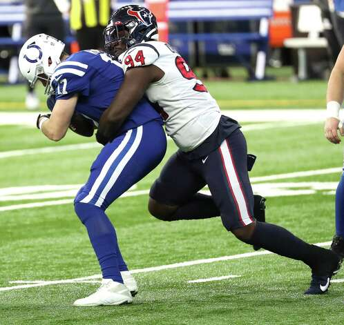 Houston Texans defensive end Charles Omenihu (94) sacks Indianapolis Colts quarterback Philip Rivers (17) during the first half of an NFL football game at Lucas  Field Sunday, Dec. 20, 2020, in Indianapolis. Photo: Brett Coomer, Staff Photographer / © 2020 Houston Chronicle