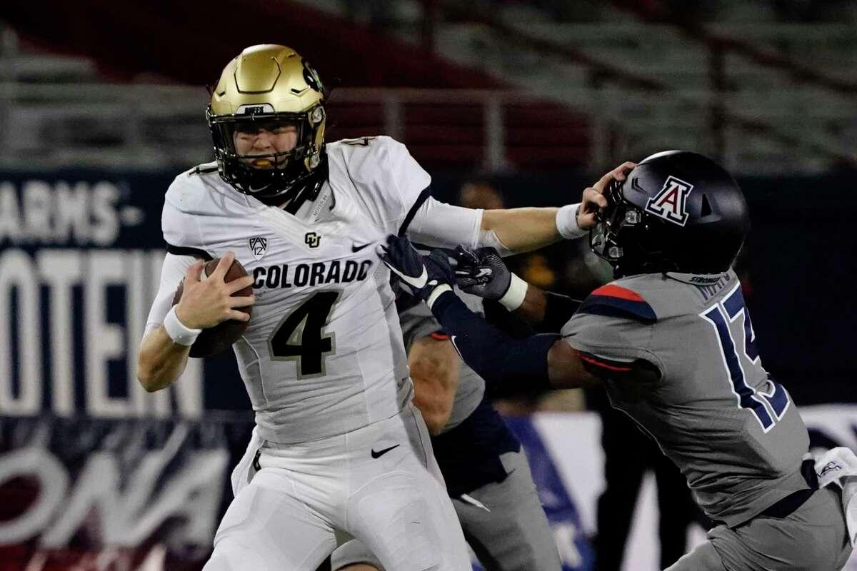 Colorado quarterback Sam Noyer (4) in the first half during an NCAA college football game against Arizona, Saturday, Dec. 5, 2020, in Tucson, Ariz. (AP Photo/Rick Scuteri)