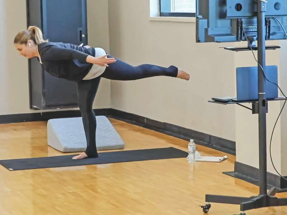 In this video still, Dr. Bernice Sánchez demonstrates a yoga posture for her virtual audience. Photo: Courtesy /TAMIU
