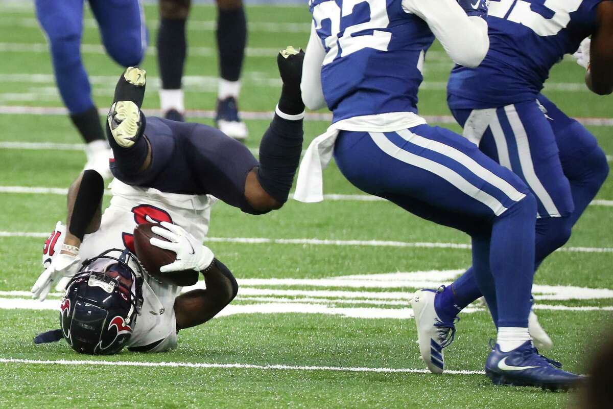 Houston Texans wide receiver Keke Coutee (16) goes head over heels after making a catch against the Indianapolis Colts during the first half of an NFL football game at Lucas Field Sunday, Dec. 20, 2020, in Indianapolis.