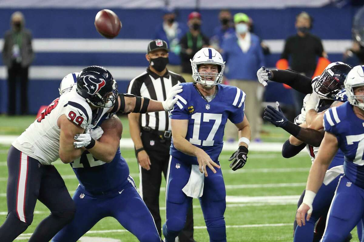 Indianapolis Colts quarterback Philip Rivers (17) gets off a pass as he is pressured by Houston Texans defensive end J.J. Watt (99) during the fourth quarter of an NFL football game at Lucas Oil Field Sunday, Dec. 20, 2020, in Indianapolis.