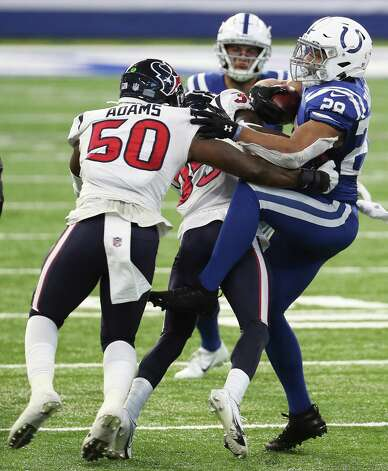 Indianapolis Colts running back Jonathan Taylor (28) is stopped by Houston Texans cornerback Keion Crossen (35) and outside linebacker Tyrell Adams (50) during the fourth quarter of an NFL football game at Lucas Oil Field Sunday, Dec. 20, 2020, in Indianapolis. Photo: Brett Coomer, Staff Photographer / © 2020 Houston Chronicle