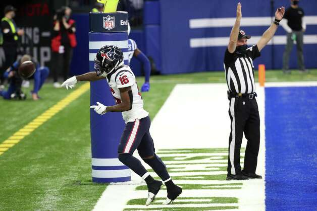 Houston Texans wide receiver Keke Coutee (16) spikes the ball after scoring on a 9-yard touchdown reception against the Indianapolis Colts during the fourth quarter of an NFL football game at Lucas Oil Field Sunday, Dec. 20, 2020, in Indianapolis. Photo: Brett Coomer, Staff Photographer / © 2020 Houston Chronicle