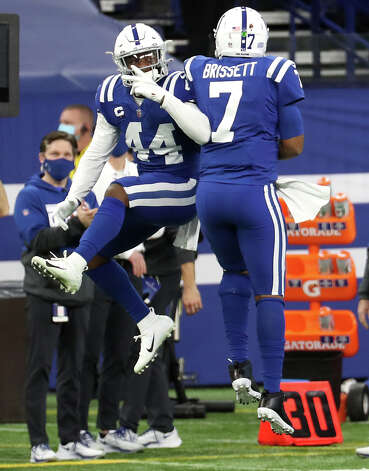 Indianapolis Colts quarterback Jacoby Brissett (7) and outside linebacker Zaire Franklin (44) celebrate after Brisset dove for a first down on fourth-and-short against the Houston Texans during the fourth quarter of an NFL football game at Lucas Oil Field Sunday, Dec. 20, 2020, in Indianapolis. Photo: Brett Coomer, Staff Photographer / © 2020 Houston Chronicle