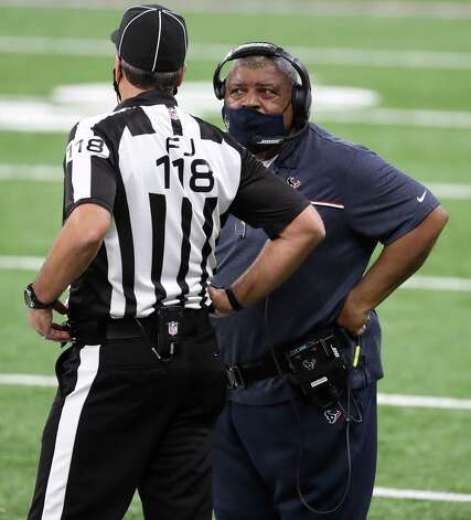 Houston Texans interim head coach Romeo Crennel talks to side judge Dave Meslow (118) during the fourth quarter of an NFL football game at Lucas Oil Field Sunday, Dec. 20, 2020, in Indianapolis. Photo: Brett Coomer, Staff Photographer / © 2020 Houston Chronicle