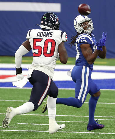 Indianapolis Colts wide receiver T.Y. Hilton (13) beats Houston Texans outside linebacker Tyrell Adams (50) for a 41-yard gain and a first down near the goal line during the fourth quarter of an NFL football game at Lucas Oil Field Sunday, Dec. 20, 2020, in Indianapolis. Photo: Brett Coomer, Staff Photographer / © 2020 Houston Chronicle