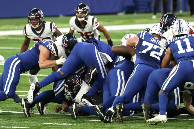 Indianapolis Colts quarterback Jacoby Brissett (7) dives for a first down on fourth-and-short against the Houston Texans during the fourth quarter of an NFL football game at Lucas Oil Field Sunday, Dec. 20, 2020, in Indianapolis. Photo: Brett Coomer, Staff Photographer / © 2020 Houston Chronicle