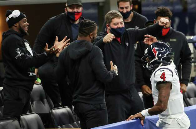 Houston Texans quarterback Deshaun Watson (4) celebrates his 9-yard touchdown throw with a group of teammates in the stands during the fourth quarter of an NFL football game against the Indianapolis Colts at Lucas Oil Field Sunday, Dec. 20, 2020, in Indianapolis. Photo: Brett Coomer, Staff Photographer / © 2020 Houston Chronicle