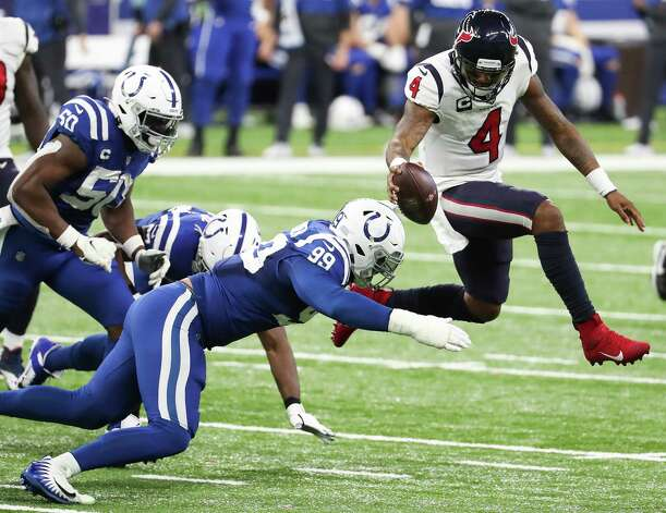 Houston Texans quarterback Deshaun Watson (4) leaps as he is hit by Indianapolis Colts defensive tackle DeForest Buckner (99) during the fourth quarter of an NFL football game at Lucas Oil Field Sunday, Dec. 20, 2020, in Indianapolis. Watson lost his balance on the play and was sacked. Photo: Brett Coomer, Staff Photographer / © 2020 Houston Chronicle