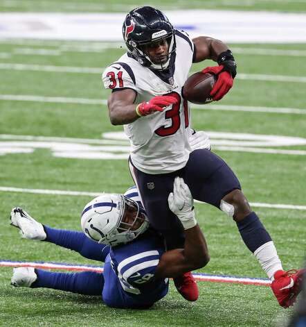 Houston Texans running back David Johnson (31) is brought down by Indianapolis Colts outside linebacker Bobby Okereke (58) during the fourth quarter of an NFL football game at Lucas Oil Field Sunday, Dec. 20, 2020, in Indianapolis. Photo: Brett Coomer, Staff Photographer / © 2020 Houston Chronicle