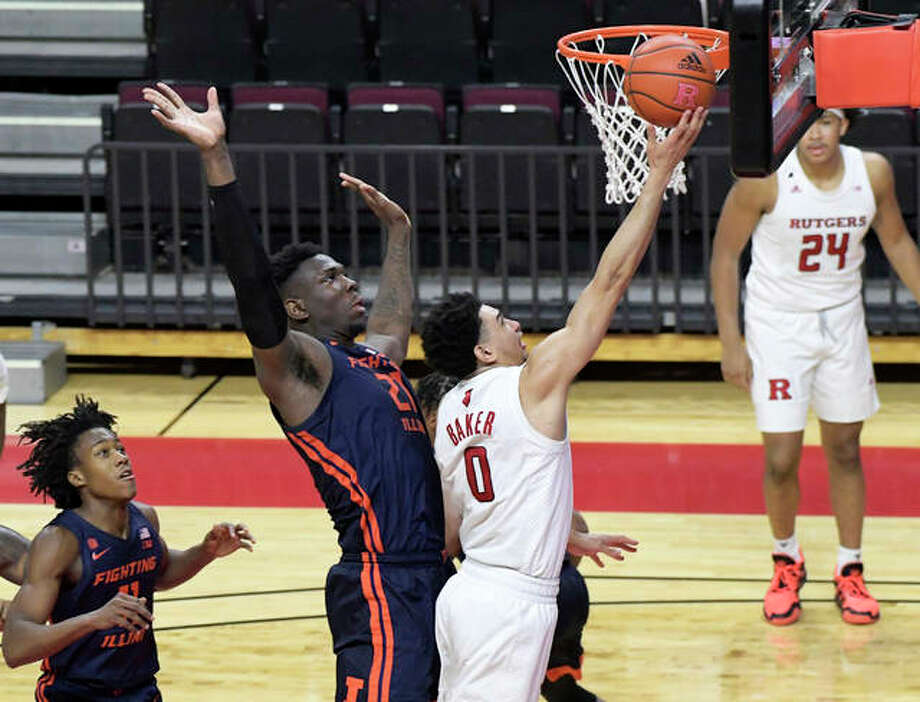 Rutgers guard Geo Baker (0) shoots as he gets by Illinois center Kofi Cockburn (21) during the second half of an NCAA college basketball game Sunday, Dec. 20, 2020, in Piscataway, N.J. Photo: Associated Press
