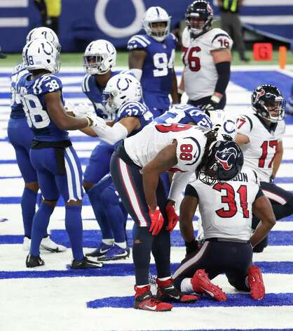 Houston Texans tight end Jordan Akins (88) and running back David Johnson (31) react after the Texans gave up a fumble in the end zone during the fourth quarter of an NFL football game at Lucas Oil Field Sunday, Dec. 20, 2020, in Indianapolis. Photo: Brett Coomer, Staff Photographer / © 2020 Houston Chronicle
