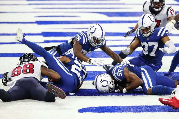 Indianapolis Colts outside linebacker Bobby Okereke (58) recovers a fumble by Houston Texans wide receiver Keke Coutee in the end zone to end the Texans scoring threat near the end of the fourth quarter of an NFL football game at Lucas Oil Field Sunday, Dec. 20, 2020, in Indianapolis. Photo: Brett Coomer, Staff Photographer / © 2020 Houston Chronicle