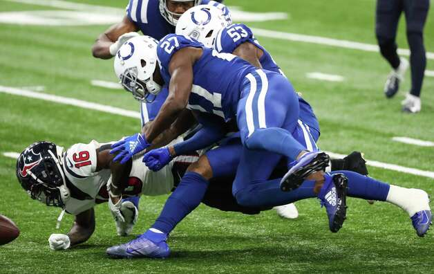 Houston Texans wide receiver Keke Coutee (16) fumbles near the goal line as he is hit by Indianapolis Colts cornerback Xavier Rhodes (27) and outside linebacker Darius Leonard (53) during the fourth quarter of an NFL football game at Lucas Oil Field Sunday, Dec. 20, 2020, in Indianapolis. The Colts recovered the fumble in the end zone to end the Texans scoring threat late in the quarter. Photo: Brett Coomer, Staff Photographer / © 2020 Houston Chronicle
