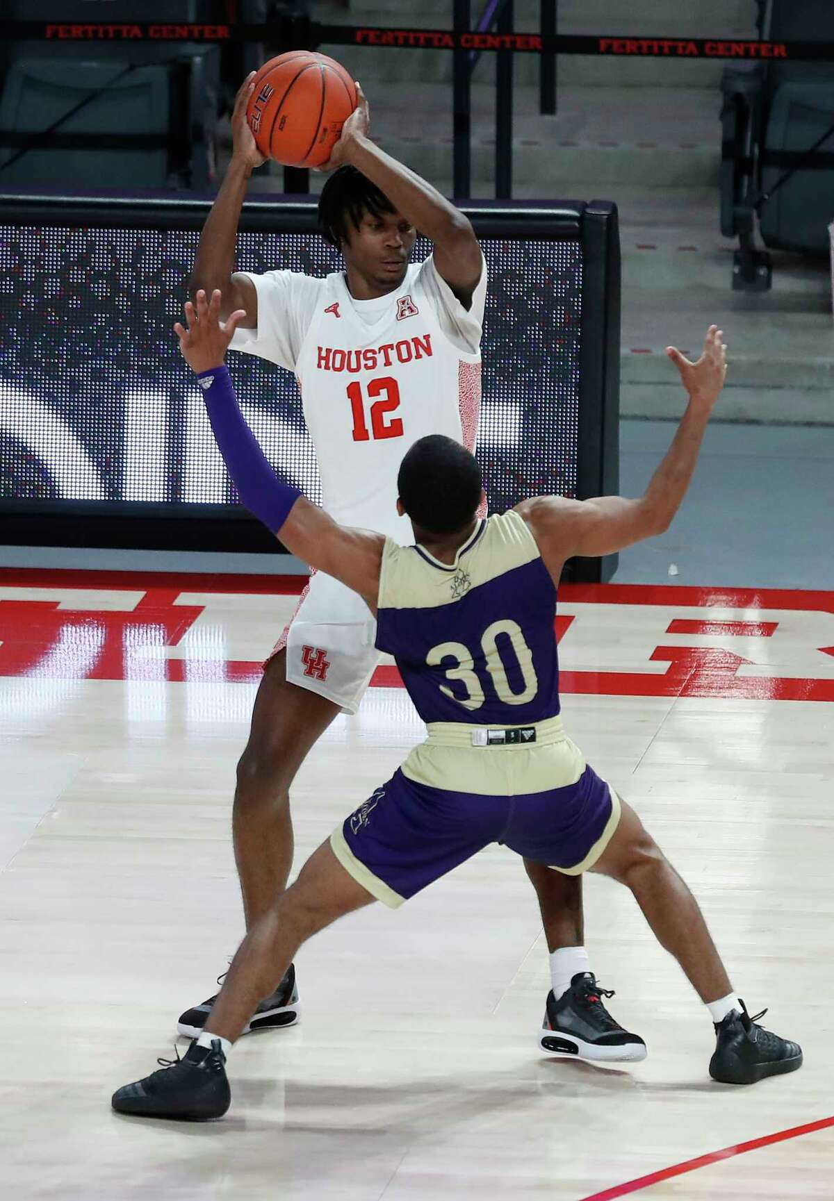 Houston Cougars guard Tramon Mark (12) works against Alcorn State Braves guard Byron Joshua (30) during the first half of an NCAA men's basketball game at Fertitta Center Sunday, December 20, 2020, in Houston.