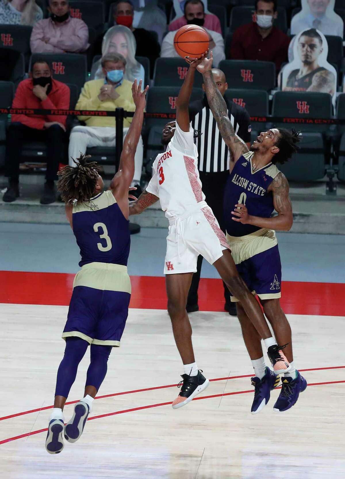Houston Cougars guard DeJon Jarreau (3) tries to get control of the ball against the defense of Alcorn State Braves guards Troymain Crosby (0) and David Pierce (3) during the first half of an NCAA men's basketball game at Fertitta Center Sunday, December 20, 2020, in Houston.