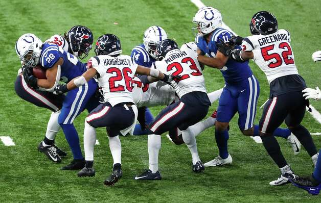 Indianapolis Colts running back Jonathan Taylor (28) runs through a host of Houston Texans defenders for a first down during the third quarter of an NFL football game at Lucas  Field Sunday, Dec. 20, 2020, in Indianapolis. Photo: Brett Coomer, Staff Photographer / © 2020 Houston Chronicle