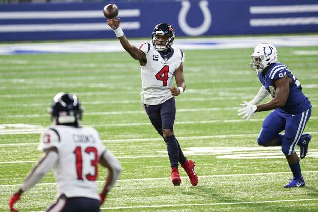 Houston Texans quarterback Deshaun Watson (4) throws a pass to wide receiver Brandin Cooks (13) as he is pursued by Indianapolis Colts defensive end Tyquan Lewis (94) during the third quarter of an NFL football game at Lucas  Field Sunday, Dec. 20, 2020, in Indianapolis. Photo: Brett Coomer, Staff Photographer / © 2020 Houston Chronicle