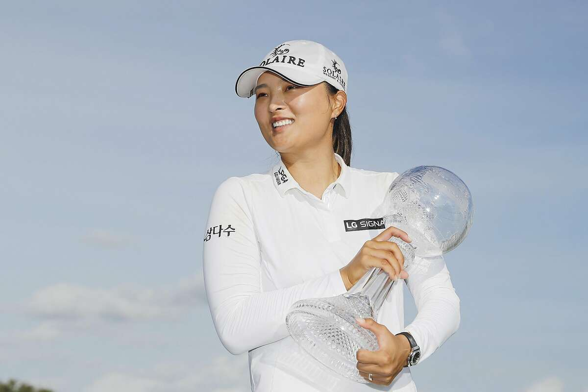 Jin Young Ko laughs with the trophy after winning the CME Group Tour Championship at Tiburon Golf Club on December 20, 2020 in Naples, Florida.