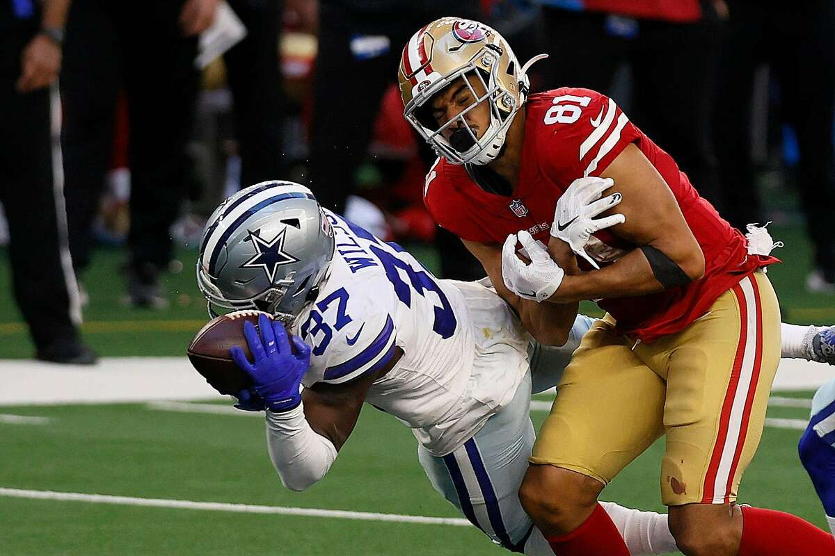 Safety Donovan Wilson #37 of the Dallas Cowboys intercepts a pass intended for tight end Jordan Reed #81 of the San Francisco 49ers during the fourth quarter at AT&T Stadium on December 20, 2020 in Arlington, Texas.