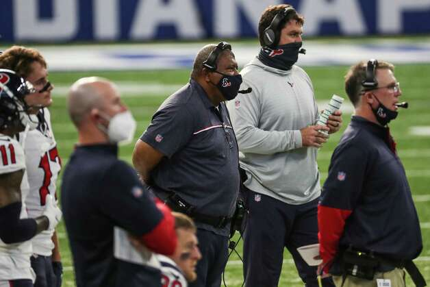 Houston Texans interim head coach Romeo Crennel and offensive coordinator Tim Kelly look on from the sidelines as they way for a play to be reviewed during the third quarter of an NFL football game against the Indianapolis Colts at Lucas  Field Sunday, Dec. 20, 2020, in Indianapolis. Photo: Brett Coomer, Staff Photographer / © 2020 Houston Chronicle