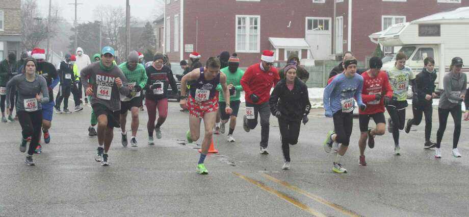 One of the many start waves set off for the Jingle Bell Jog 5K on Saturday in Manistee. (Dylan Savela/News Advocate)