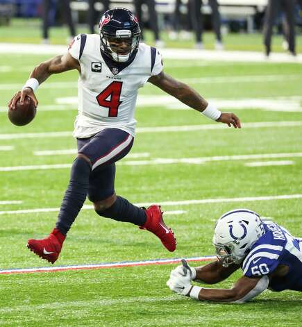 Houston Texans quarterback Deshaun Watson (4) leaps out of the grasp of Indianapolis Colts defensive end Justin Houston (50) during the first half of an NFL football game at Lucas  Field Sunday, Dec. 20, 2020, in Indianapolis. Photo: Brett Coomer, Staff Photographer / © 2020 Houston Chronicle