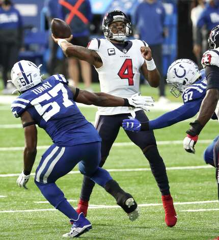 Houston Texans quarterback Deshaun Watson (4) throws a pass as he is pressured by Indianapolis Colts defensive end Kemoko Turay (57) and defensive end Al-Quadin Muhammad (97) during the first half of an NFL football game at Lucas  Field Sunday, Dec. 20, 2020, in Indianapolis. Photo: Brett Coomer, Staff Photographer / © 2020 Houston Chronicle
