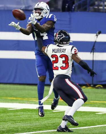 Indianapolis Colts wide receiver Zach Pascal (14) leaps over Houston Texans free safety Eric Murray (23) for a first down reception during the first half of an NFL football game at Lucas  Field Sunday, Dec. 20, 2020, in Indianapolis. Photo: Brett Coomer, Staff Photographer / © 2020 Houston Chronicle
