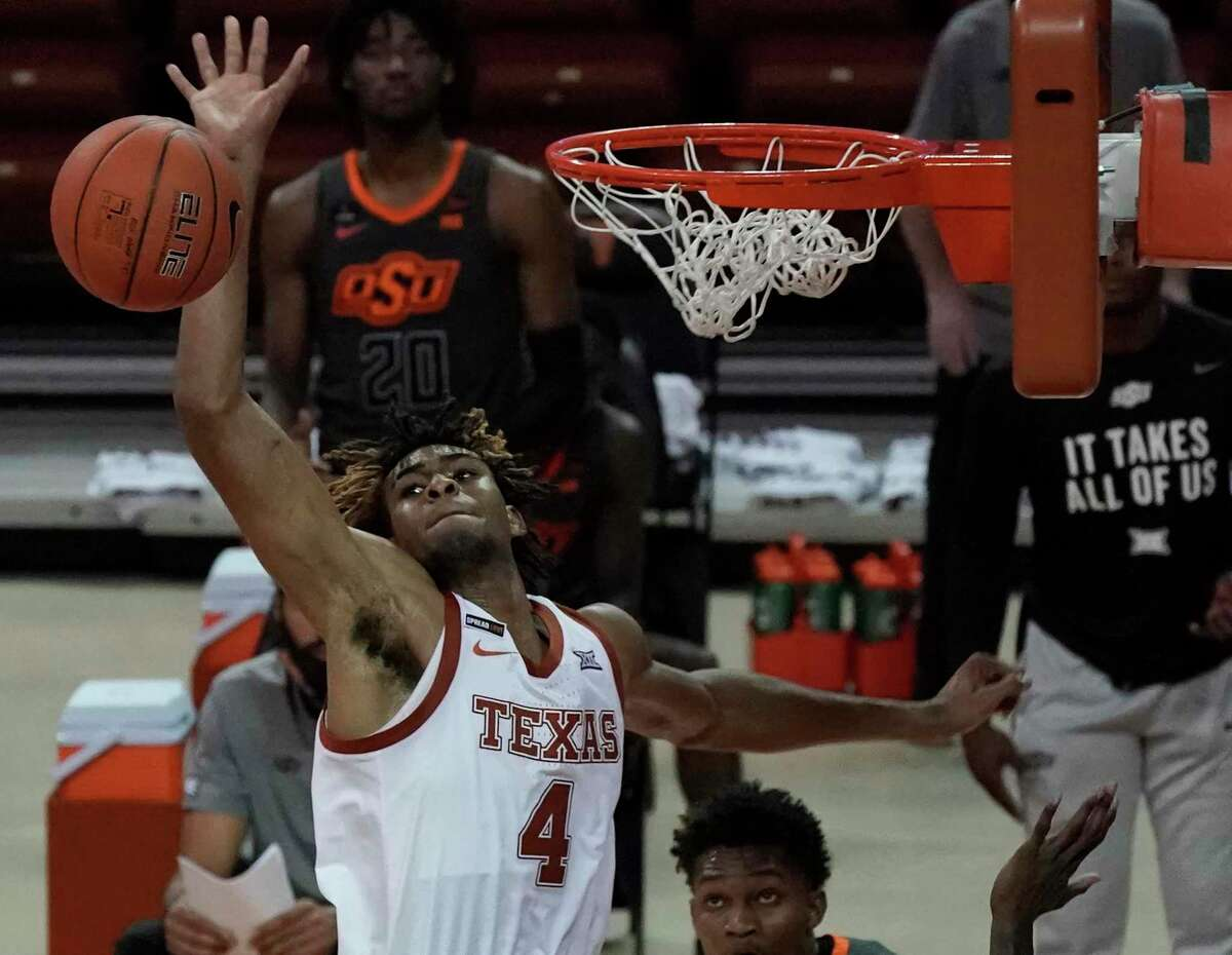 Texas freshman Greg Brown soars for one of his three blocked shots in the Longhorns' 77-74 victory over Oklahoma State on Sunday at the Erwin Center.