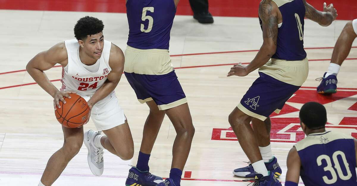Houston Cougars guard Quentin Grimes (24) tries to pass the ball around Alcorn State Braves forward Tyree Corbett (5) during the first half of an NCAA men's basketball game at Fertitta Center Sunday, December 20, 2020, in Houston.