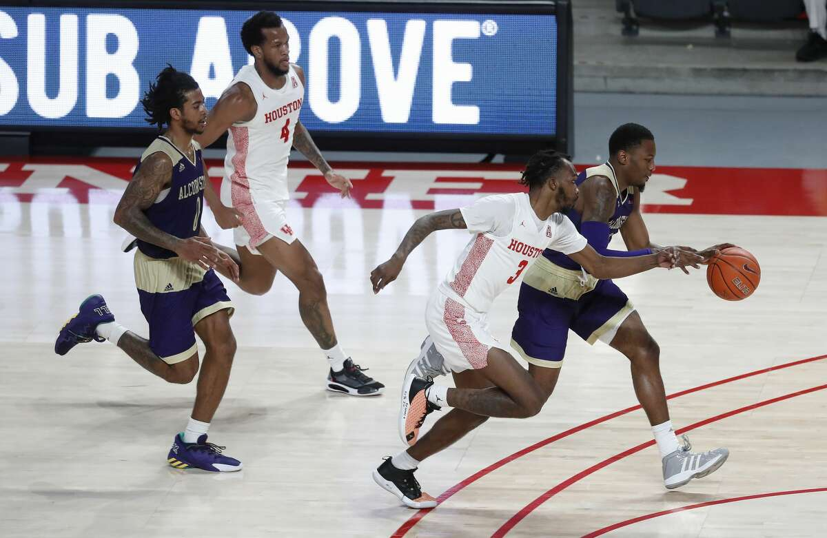 Houston Cougars guard DeJon Jarreau (3) chases Alcorn State Braves guard Tajah Fraley (11) during the second half of an NCAA men's basketball game at Fertitta Center Sunday, December 20, 2020, in Houston.
