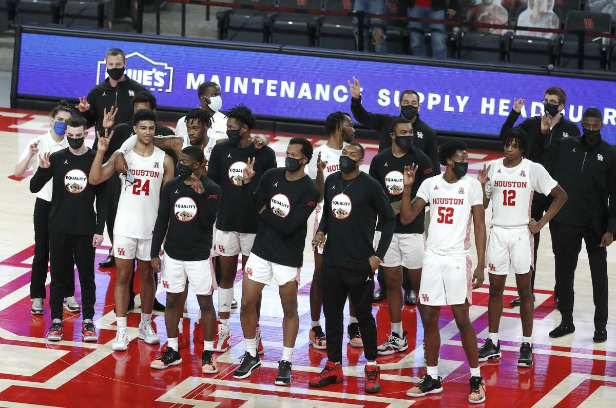 The Houston Cougars celebrate their 88-55 win over the Alcorn State Braves after an NCAA men's basketball game at Fertitta Center Sunday, December 20, 2020, in Houston.
