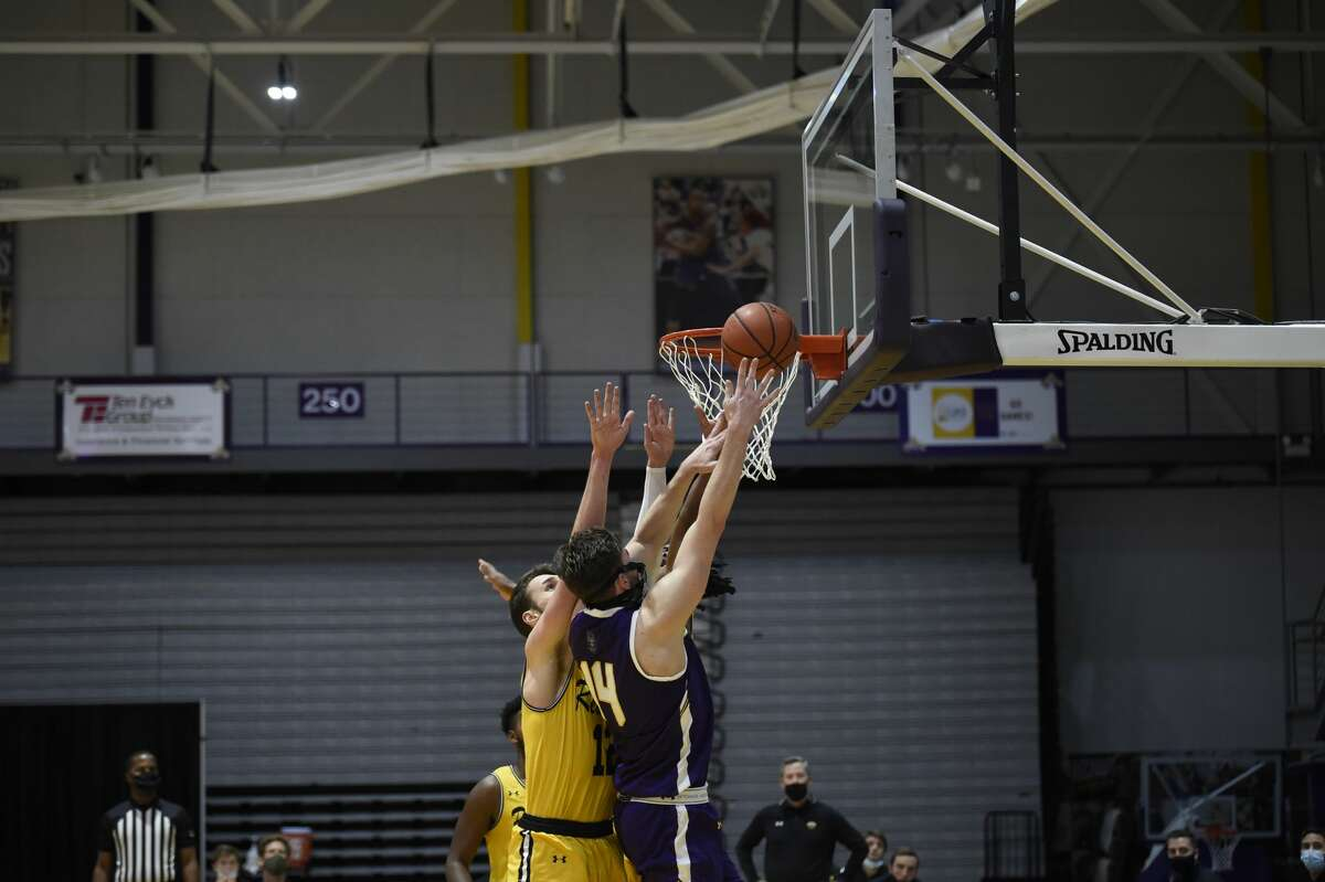 UAlbany junior forward Adam Lulka makes a layup despite a collision with UMBC's Brandon Horvath during an America East Conference basketball game Sunday, Dec. 20, 2020, at SEFCU Arena. (Kathleen Helman/UAlbany athletics)