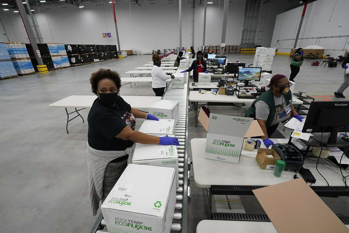Boxes containing the Moderna COVID-19 vaccine are prepared for shipment at the McKesson distribution center in Mississippi on Sunday. The Moderna vaccine could reach the Bay Area as soon as Monday.