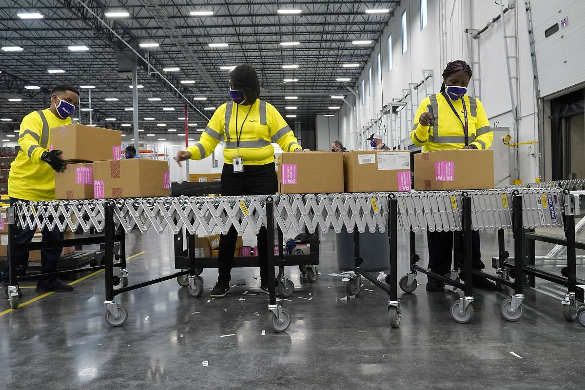 Boxes containing the Moderna coronavirus vaccine are prepared to be shipped at a McKesson distribution center in Mississippi on Sunday.