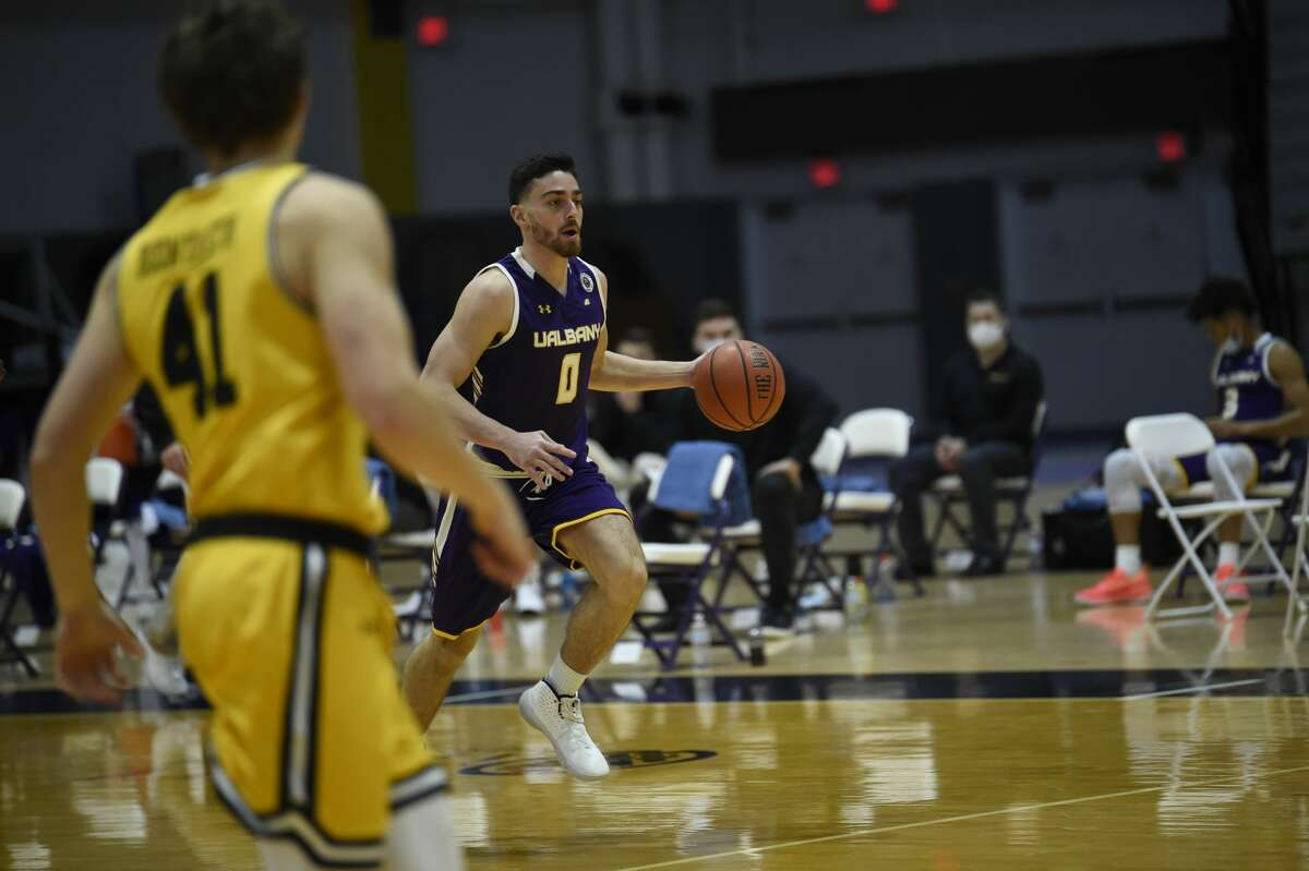 UAlbany junior guard Antonio Rizzuto brings the ball upcourt against UMBC unb an America East Conference basketball game Sunday, Dec. 20, 2020, at SEFCU Arena. (Kathleen Helman / UAlbany athletics)