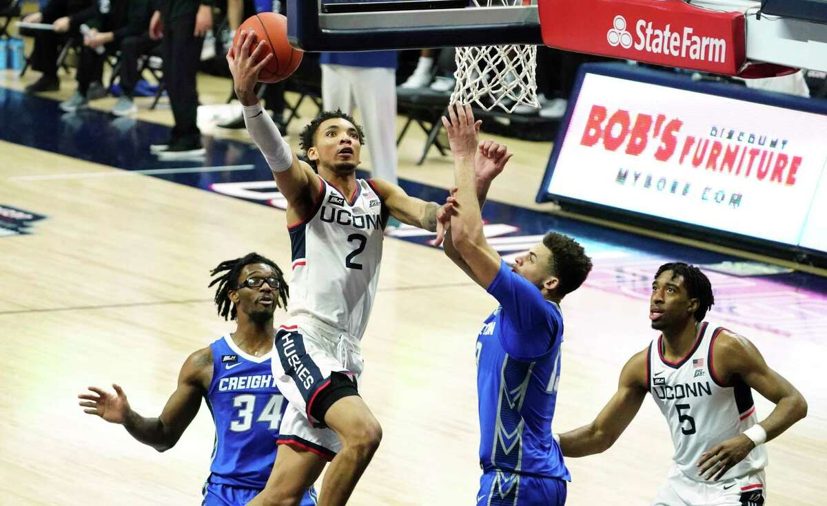 UConn's James Bouknight (2) drives the ball to the basket against Creighton in the second half on Sunday.