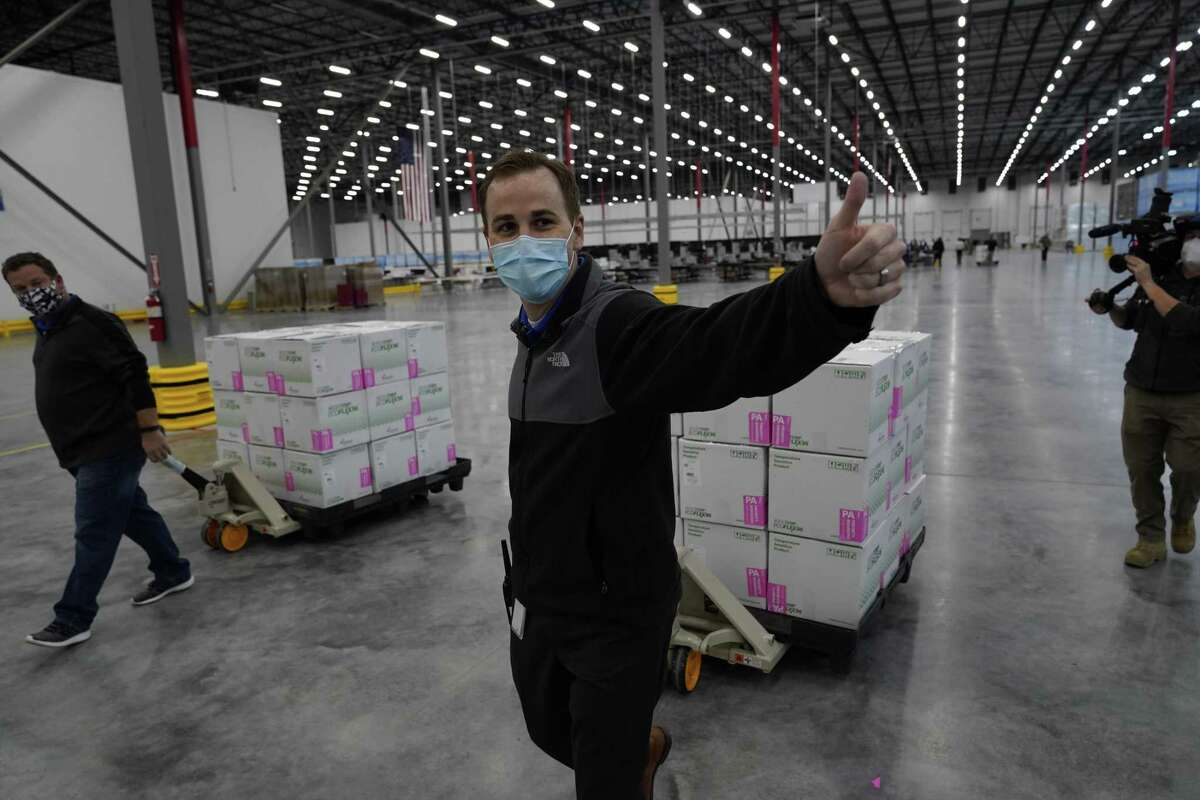 Boxes containing the Moderna COVID-19 vaccine are prepared to be shipped at the McKesson distribution center in Olive Branch, Mississippi.