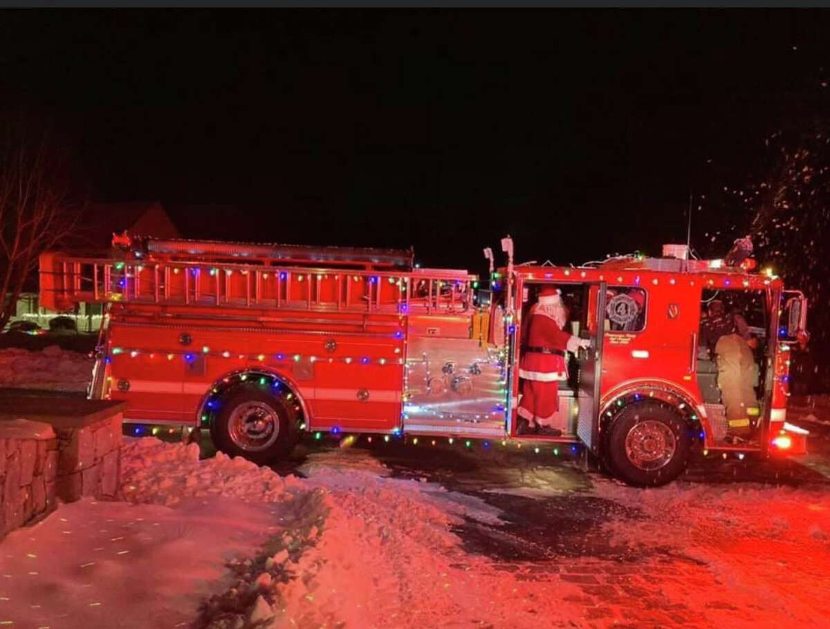 Santa Claus rode on a fire truck Saturday night around Bethlehem, delivering Christmas presents.
