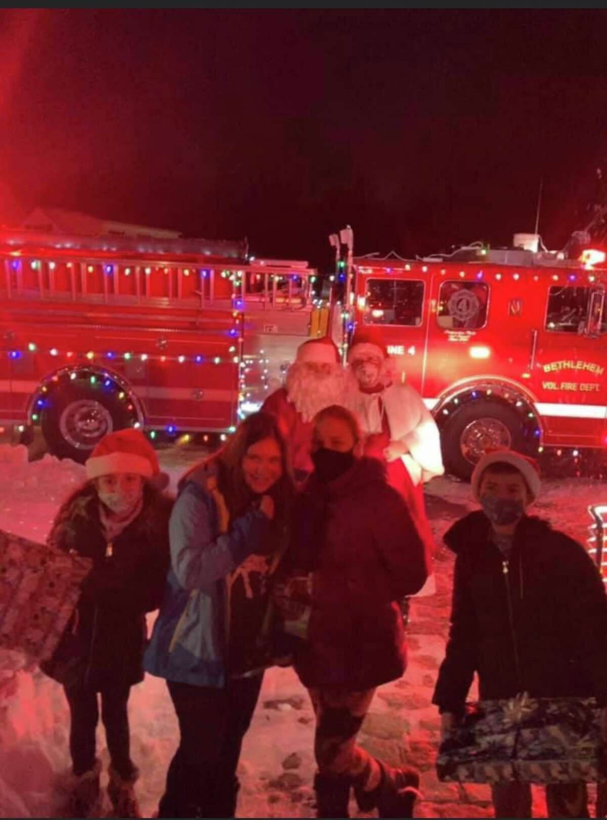 Children from Bethlehem receive Christmas presents from Santa Claus on Saturday night, on his annual Santa Run tradition.